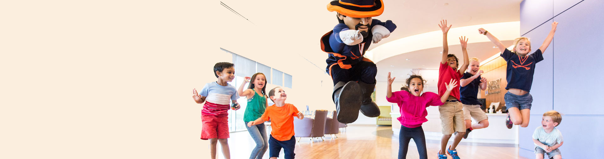 kids play with UVA mascot